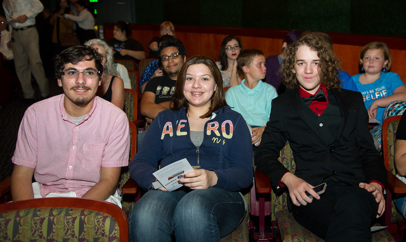 Ben Gueri (left), Emma Seguneo, and Austin Young wait patiently for Bill Nye's presentation.