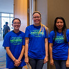 Kaleo Oshiro, Justine Thomas, and Rita Martinez work as volunteers for the 12th Annual Pathways Symposium.