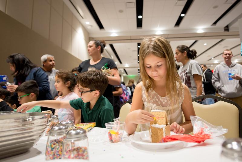 Serenity Lott creates a festive snack during the TAMU-CC Islander Lights Celebration.