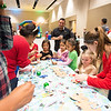 Guests at the TAMU-CC Islander Lights celebration create Christmas themed crafts.
