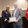 LTG Larry Wyche is presented a certificate for his contribution by President and CEO of TAMU-CC Flavius Killebrew.
