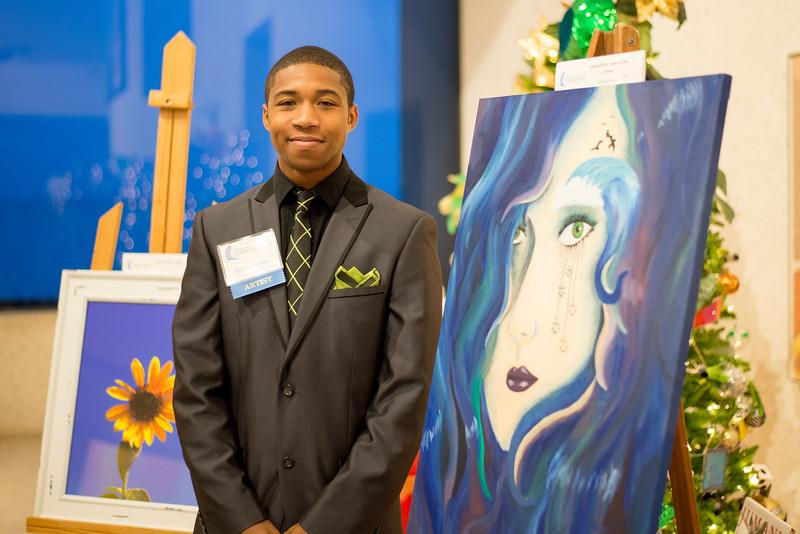 """TAMU-CC student Michael Bailey, stands next to his art work titled """"Amphitrite Tears of the Ocean."""" During the 2015 President's Council Art Show."""