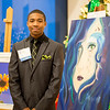 "TAMU-CC student Michael Bailey, stands next to his art work titled ""Amphitrite Tears of the Ocean."" During the 2015 President's Council Art Show."