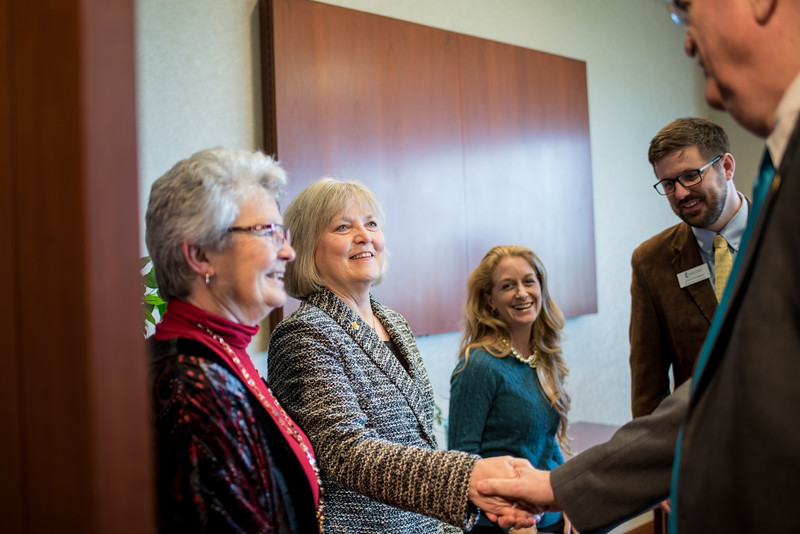 Dr. Even Layman (left) greets Dr. Flavius Killebrew  during the Layman Professorship Signing Luncheon in TAMU-CC. Wednesday December 16, 2015.