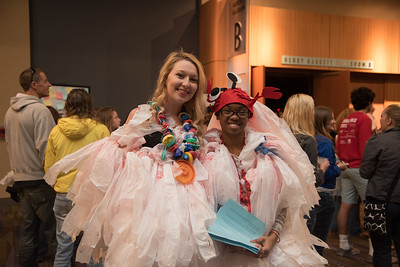 Katlyn Garrett(left) and Olivia Wright with their customized plastic bag shirt at the Blue On Tour event at the American Bank Center.
