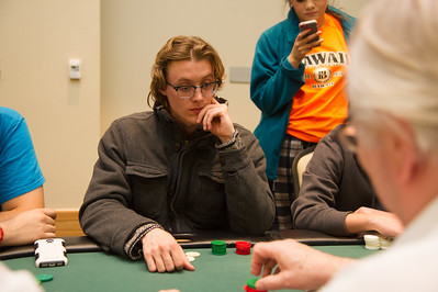 Douglas Dohmeyer thinking immensely at poker during the Islanderino.
