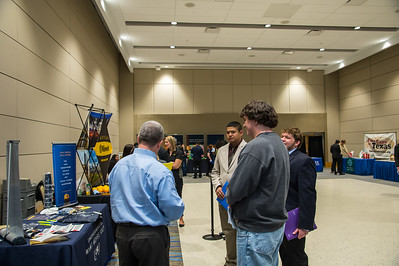 Students observe and interact with different companies in the Science and Engineering career fair