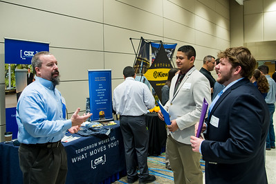 Charles Park of CSX speaks to Students Tyler Wandy and Cesar Morales at he Science and Engineering career fair