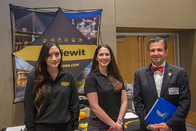 Luaren  Hausler and Nicole Reid representing Kiewit while Richard Marroquin visits for more information at the Business Career Fair