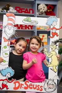 Elementary kids celebrating Dr.Seuss birthday.