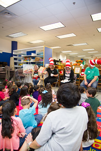 Cate Rudowsky reading Dr.Seuss books to the children.