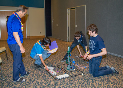 "Competitors in the ""Robot Arm"" event of the Science Olympiad get scored on how many objects they were able to place in the egg cartons."