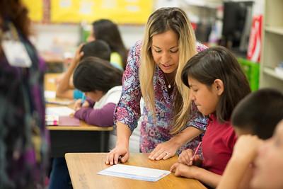 Debra Manfredi speaks to student Lluvia Torres at Zavala Elementary.