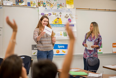 Kyra Hayman(left) and Debra Manfredi, students from TAMU-CC's college of business speak to scholars at Zavala Elementary.