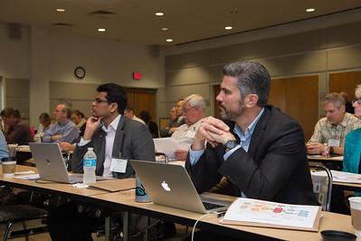 Aswani Volety (left) and David Yoskowitz listening to the presentation.