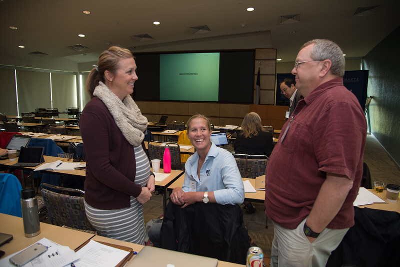 Kiersten Stanzel (left), Katie Swanson, and Mark Woodrey getting ready for the Ecohealth Metrics presentation.