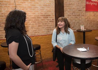 Cassandra Lorentson(left) speaks to Erika Rivera at the COMM Week Networking Mixer.