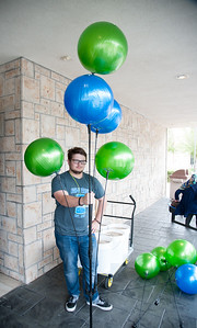 Student Dylan Kellner stands strong with his bouquet of balloons.