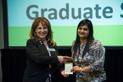 graduate student Ruma Chatteryn recieves her proze for winning the 2nd place award