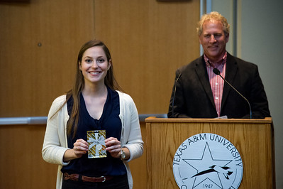 graduate student Alora Korb recieves her prize for winning people's choice award