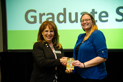 graduate student Alexandra Epple recieves her award for 1st place award