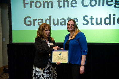 graduate student Alexandra Epple recieves her award for presenting her 3 minute thesis