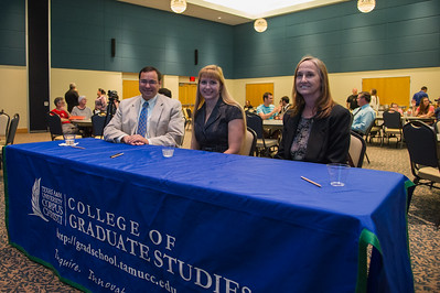 Judges from the College of Graduate studies, Gary Ramirez, Avery Scherer, and Carole Moody judge the 3 minute thesis presenters