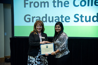graduate student Ruma Chatteryn recieves her award for presenting her 3 minute thesis