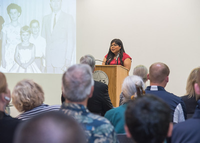 Student Government Association President Jasmine Rodriguez speaks to a crowd about Dr. Hector P. Garcia.