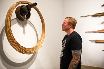 Wes Hennig observes the art set up in the Weil Gallery
