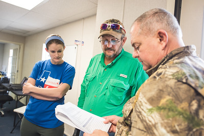 Melanie Neely(left) Dave Kennedy and Jerry Hendrix review the communication plan for the national synchronized UAS test site launch with NASA. Tuesday April 19, 2016 in Port Mansfield, Tx.