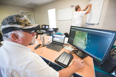 Rick Petermann with Lone Star UAS, views a real time air traffic map of the area around the Lone Star UAS test site in Port Mans field. Tuesday April 19, 2016