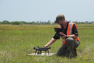 Pilot in command Steve Warr initiates the start up process on the 3DR Solo quadcopter. During the Lone Star UAS launch in Port Manfield, Tx.
