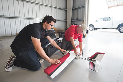 Daneil Mendez and Maurice Griffin work on assembling the PrecisionHawk Lancaster prior to the Lone Star UAS launch in Port Mansfield, Tx.