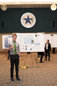 Jackson Konestski poses in front of his presentation during the McNair Poster Presentation.