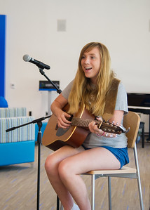 Olivia Whitehurst sings and plays guitar for a crowded Tejas Lounge during CAB's Coffeehouse.