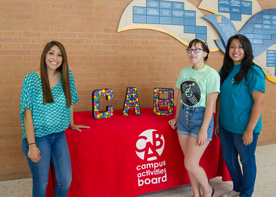 Ashlee Salazar (left), Ariah Guerra, and Charicee Cervantez host CAB's Coffeehouse in the Tejas Lounge.
