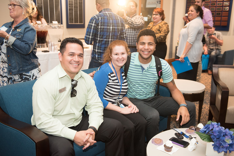 Steven Silvas(left), Abigail Jones and Tevin Williams pause for a photograph during the TAMU-CC Lavender event.