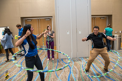 Campus staff members having a blast hulla-hooping at the Break in the Day event