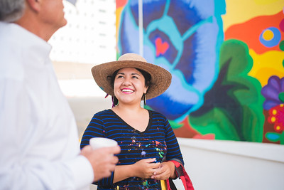 A pedestraian stops by to comment on Sandra Gonzalez's work on the Corpus Christi Mural displayed on the Caller Times building. Thursday June 16, 2016.