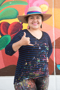 Sand Gonzalez a TAMU-CC Alum. Shows Islander spirit in front of her mural at the Corpus Christi - Caller Times.