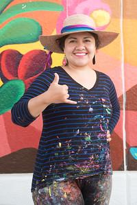 Sand Gonzalez a TAMU-CC Alum. Shows Islander spirit in front of her mural at the Corpus Christi - Caller Times.
