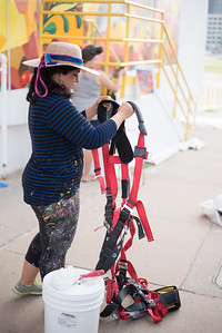 Sandra Gonzalez, TAMU-CC Alumn. Prepares her harness as she arrives to finish the work on the mural being displayed at the Caller-Times building in downtown Corpus Christi, Tx.