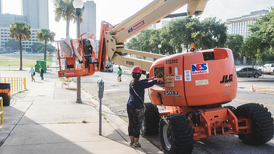 Sandra Gonzalez, prepares the boom lift. Thursday June 16 as she arrives to work on the mural of Corpus Christi on the Caller-Times building.