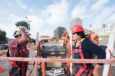 Natash Perez(left) and Sandra Gonzales, prepare to go up and place the final panels of the Corpus Christi - Mural.