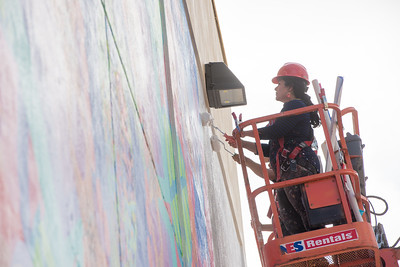 Sandra Gonzalez applies acrylic palmer before setting the pre painted clothing panels on the Corpus Christi Mural. Thursday June 16, 2016.