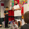 A robotics expert come does a presentation with his robot for the writing class.