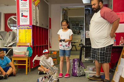 Students of the robots class are given the chance to control the robot.