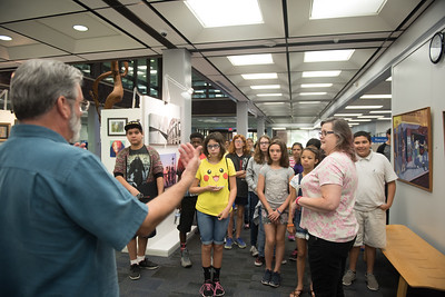 Library staff, Jeffrey Janko asks students to move closer during the tour of the Mary and Jeff Bell Library.