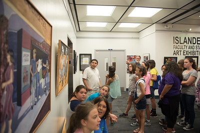 Students in the Young Writers Camp, take part in a tour of the Mary Jeff Bell Library. Led by Jeffrey Janko